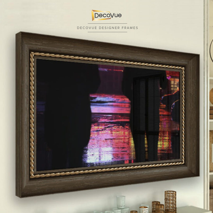 Framed smart vanishing mirror TV in wood with gold braided accent.