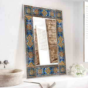 Lighted mirror with ceramic frames inspired by the Mediterranean region.